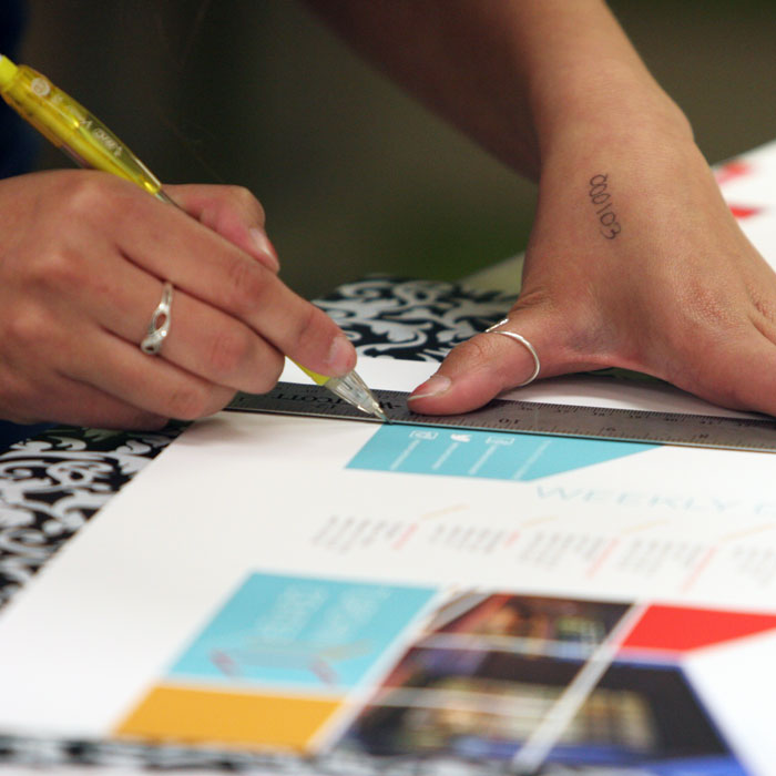 Graphic Design student trims project