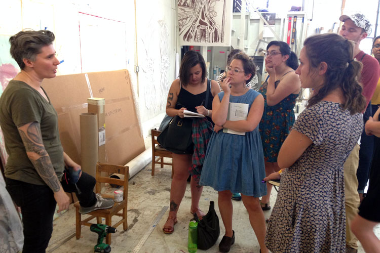 Photo of students visiting an artist's studio