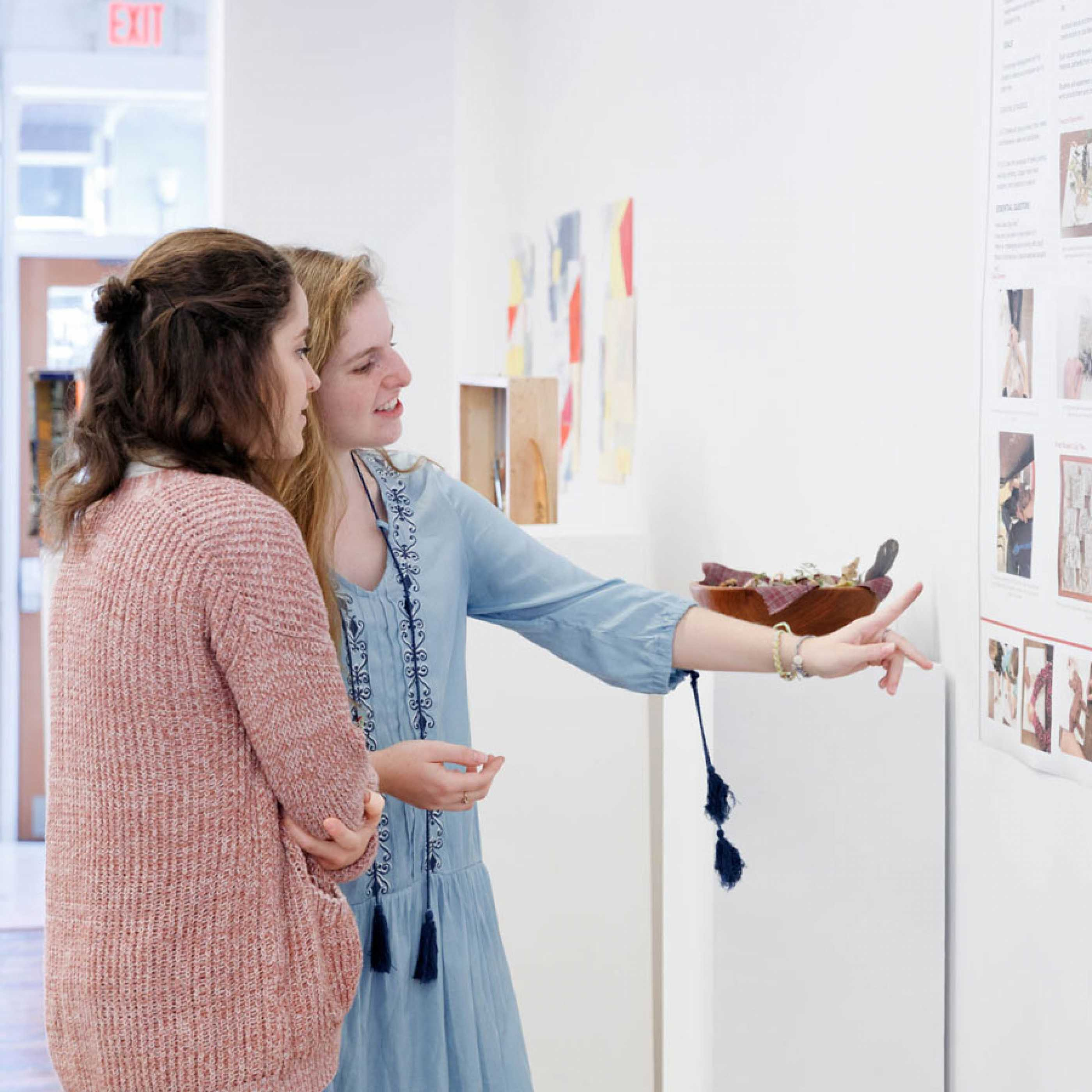 Art Education students viewing research posters