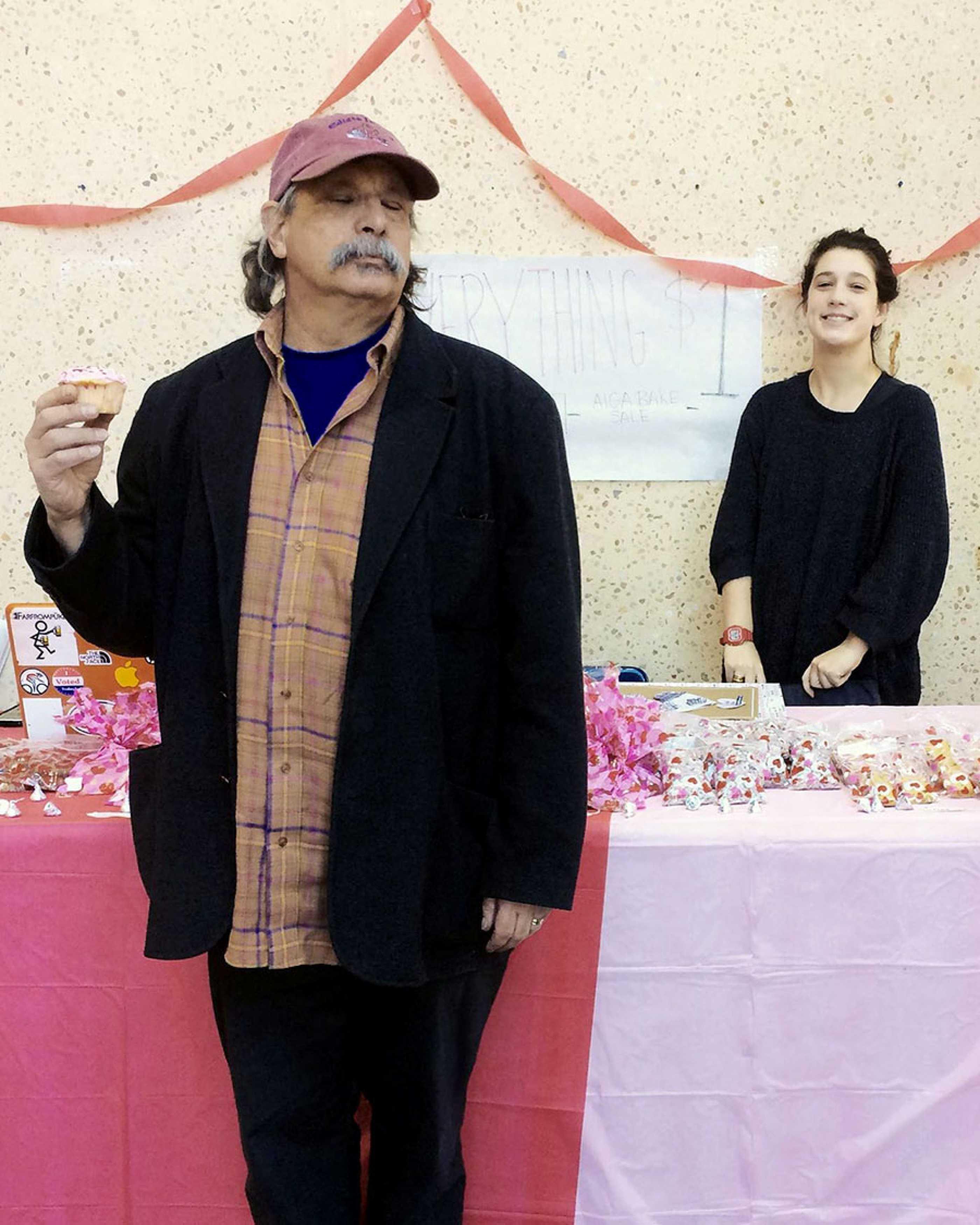 Gary Nemcosky enjoys a cupcake