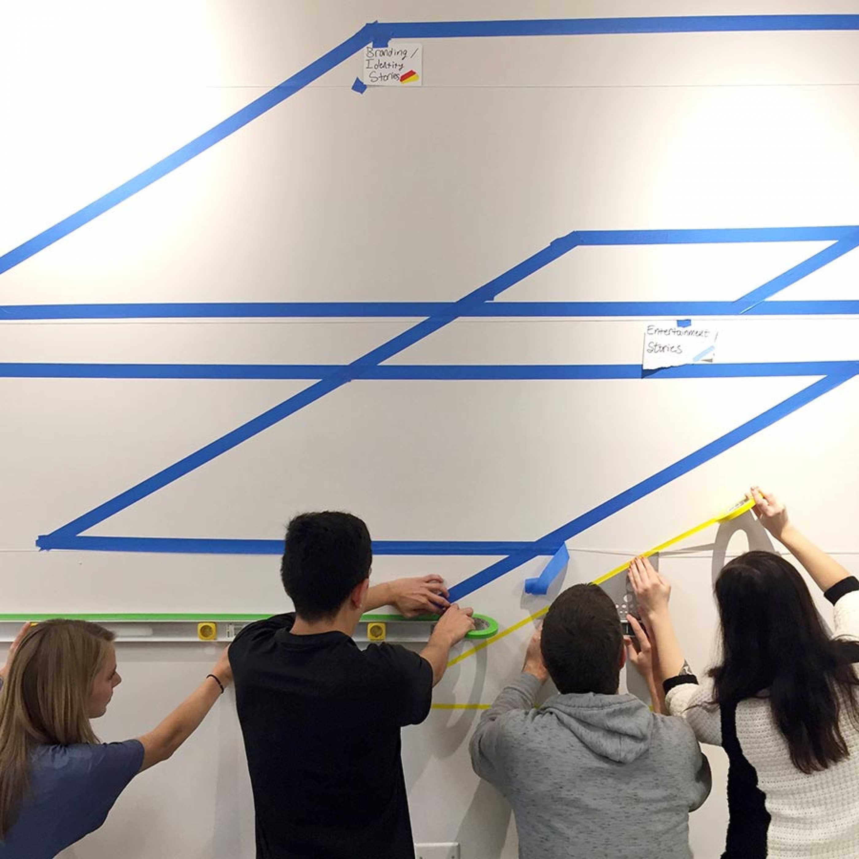 Students installing work in gallery