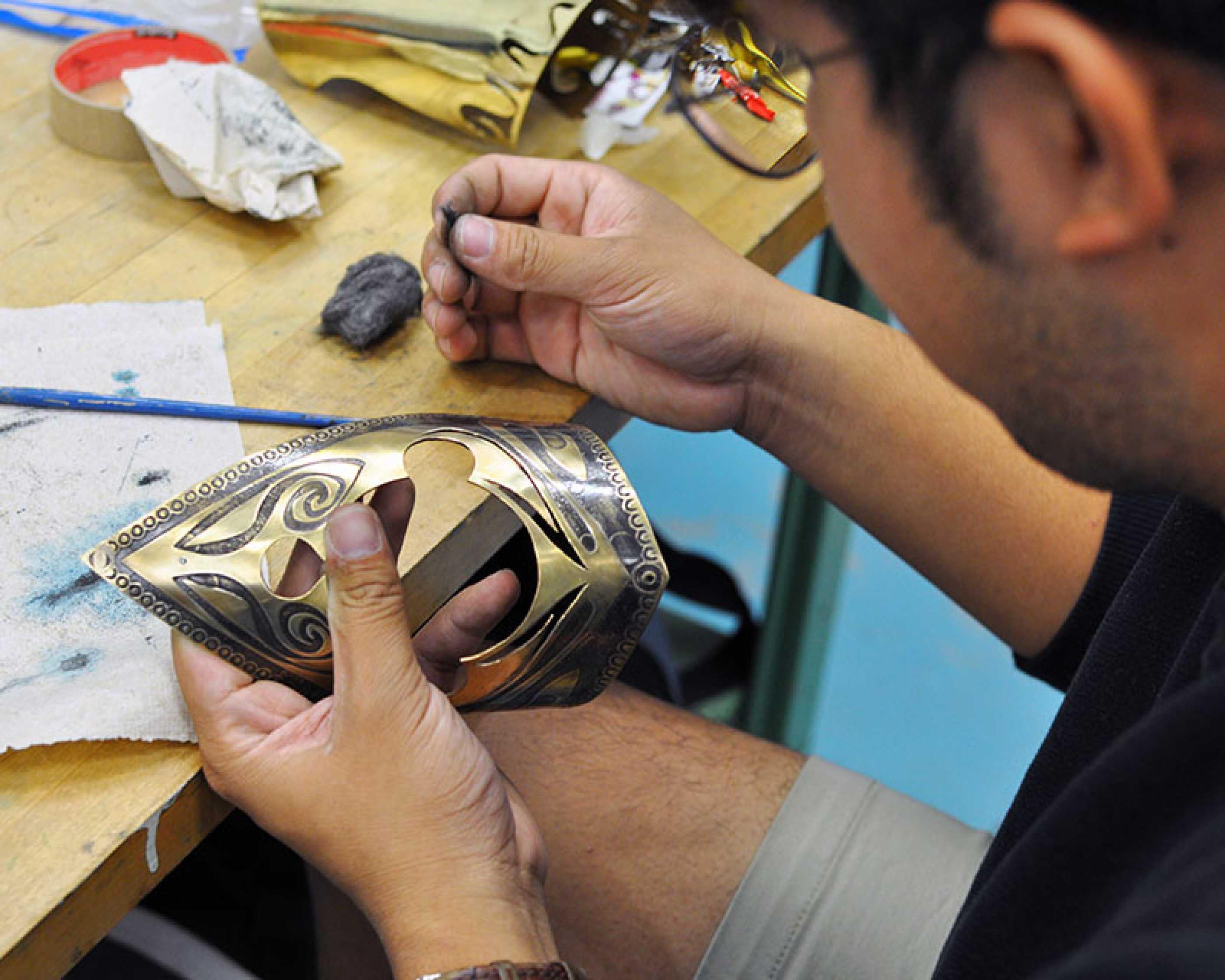 Student working in metals studio