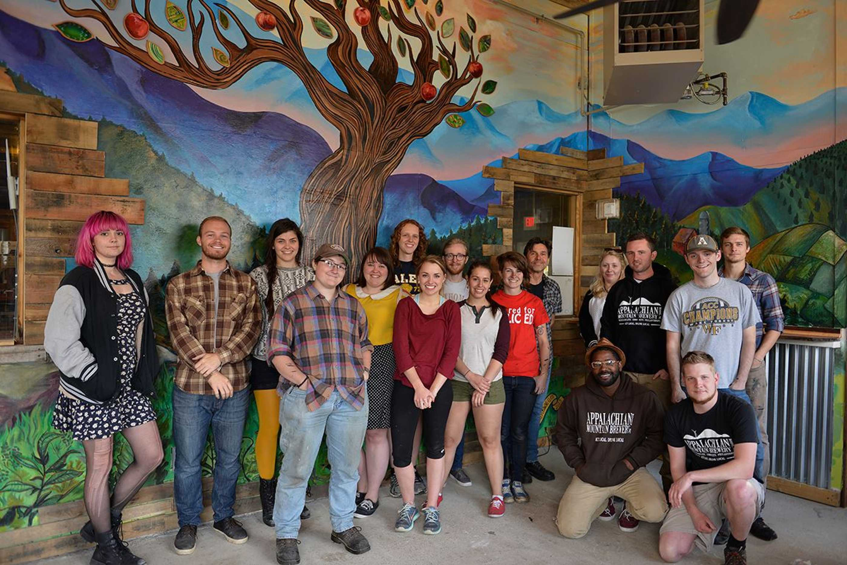 Advanced Drawing class in front of mural at Appalachian Mountain Brewery