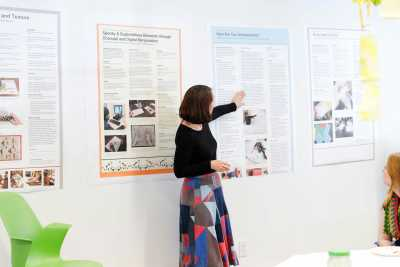 Art Education Professor Dr. Brooke Hofsess speaks about student lesson plans during the Intro Art Ed. class showcase.
