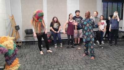 Students participating at an African Dance workshop giving them an opportunity to experience dancing in a mask