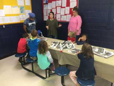 Elementary Ed. students work with young people to create environmental artwork with papier-mache through the Kaleidoscope afterschool program.