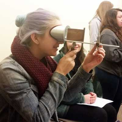 Looking through a stereoscope at the Rubenstein Special Collections Library at Duke University