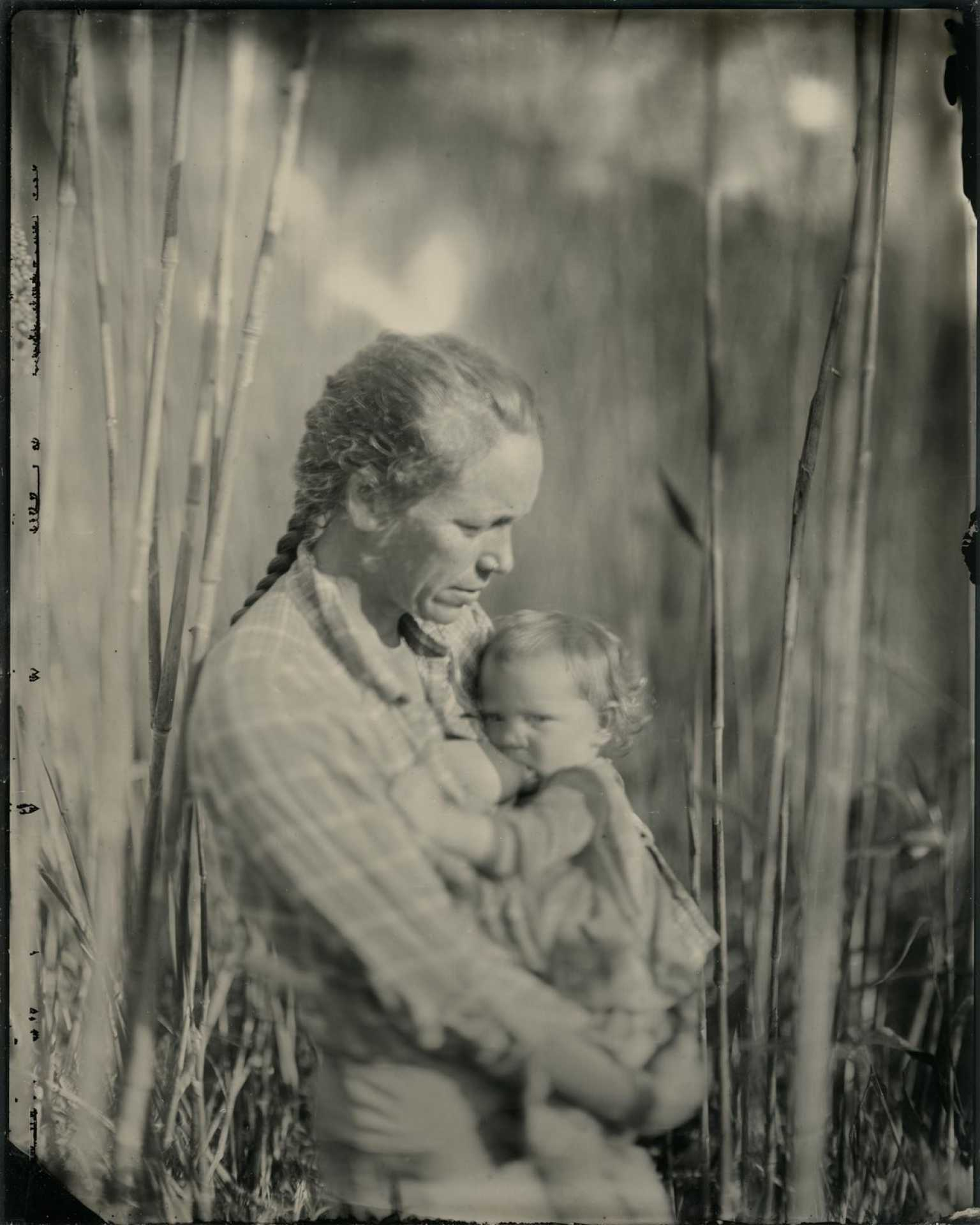Photo of woman and child in field by Joshua White