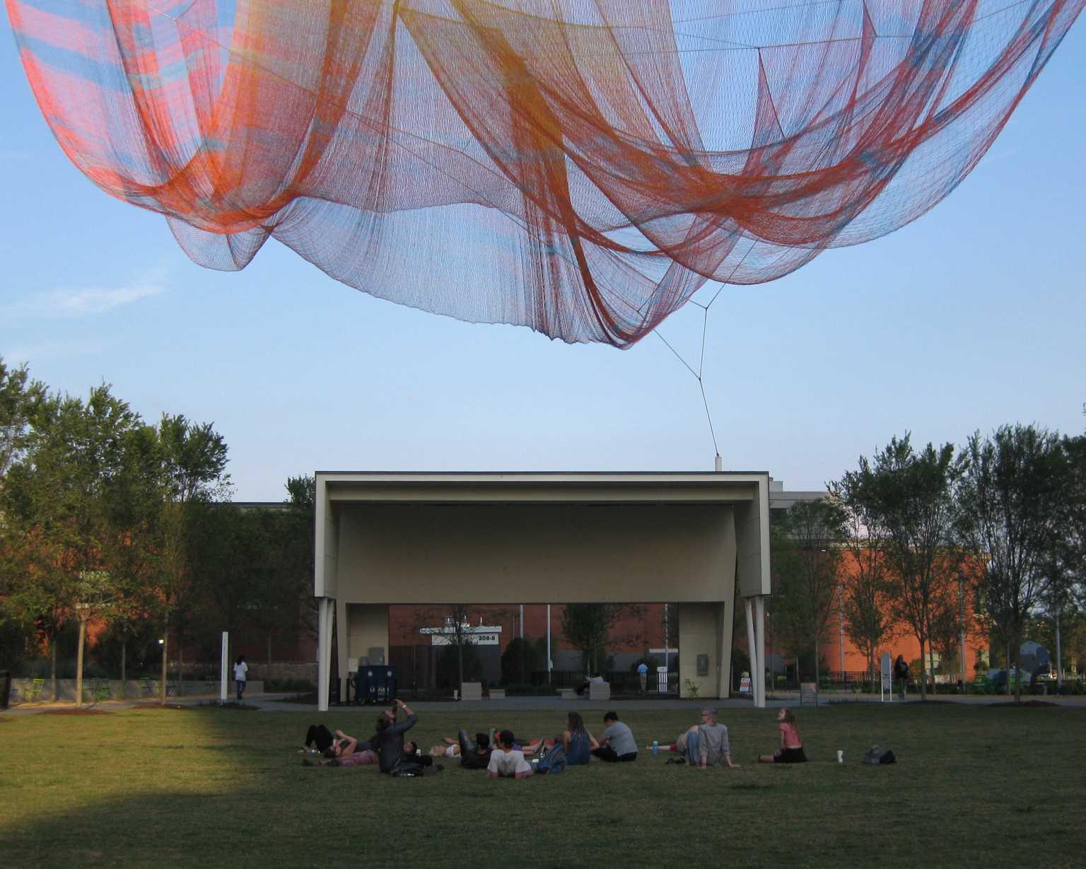 """Relaxing under Janet Echelman's """"Where We Met"""" in Greensboro"""
