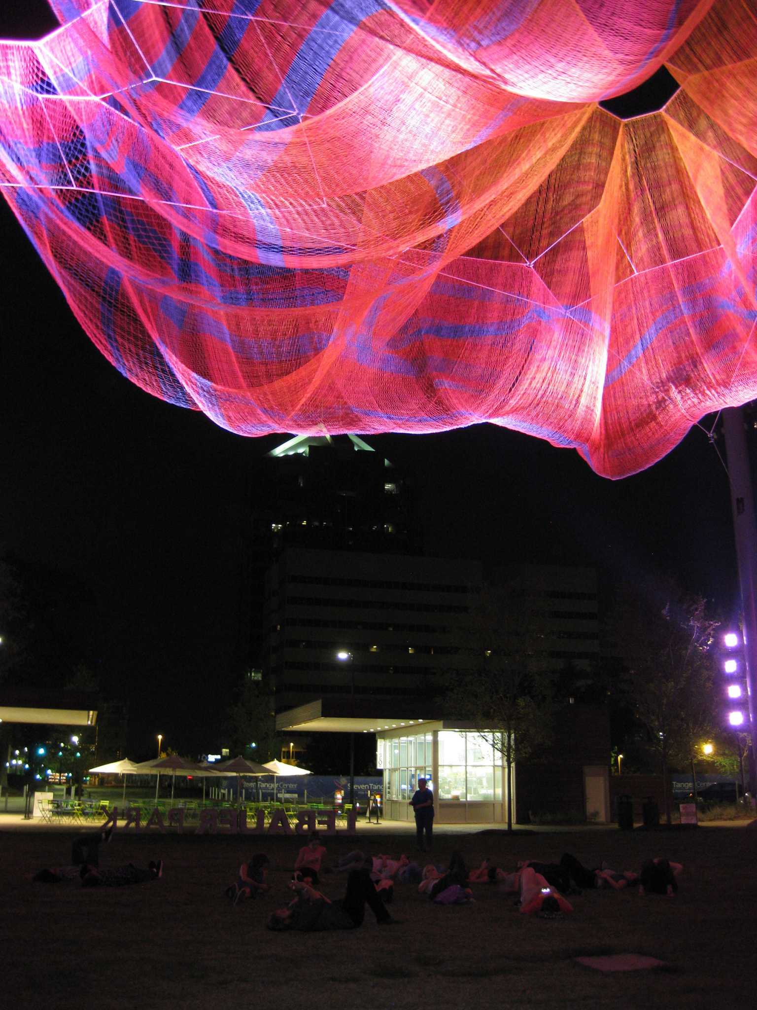 "Relaxing under Janet Echelman's ""Where We Met"" in Greensboro"