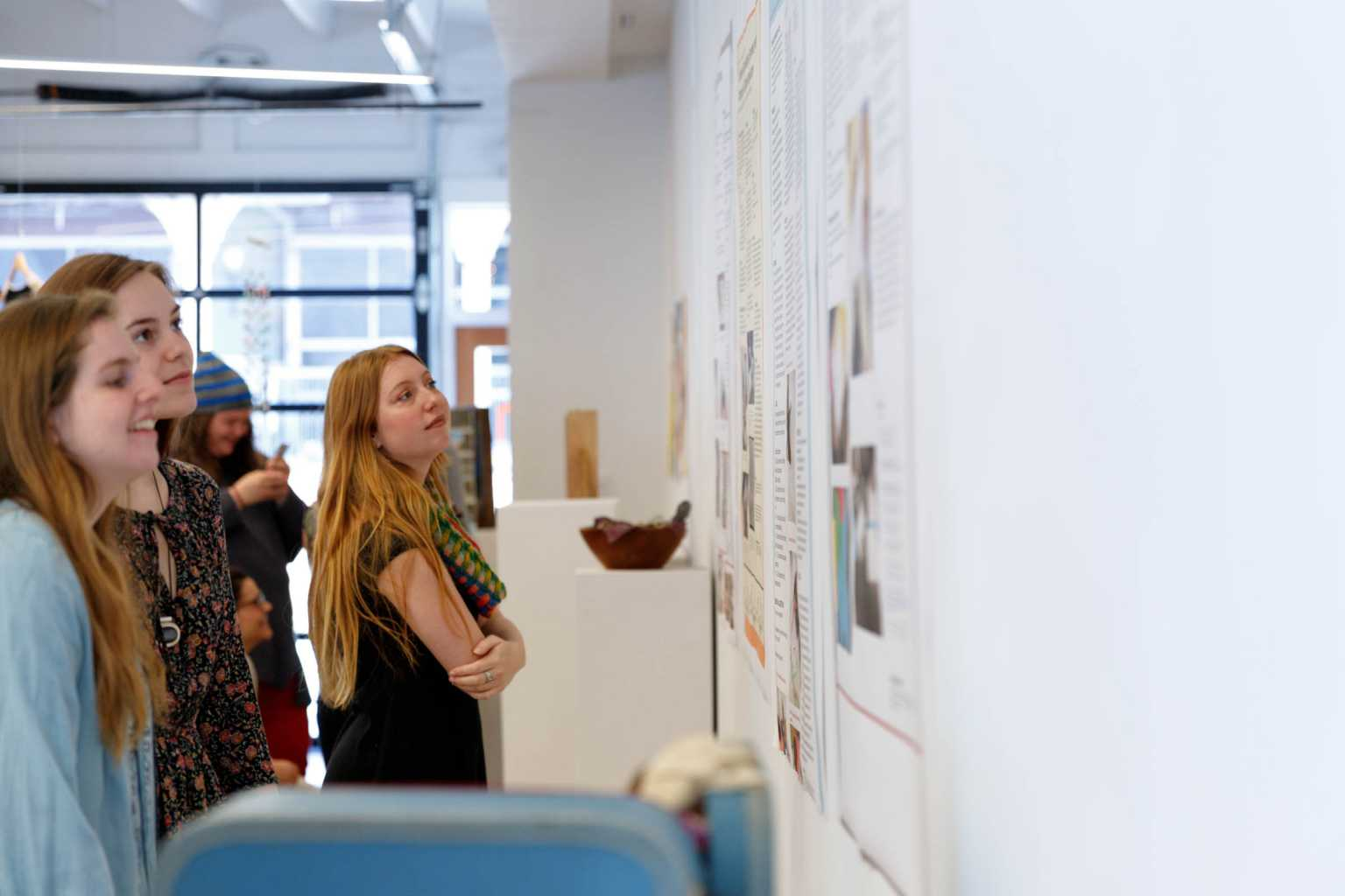 Intro. Art Ed. students admire each other's lesson plans during the Intro. Art Ed. showcase.