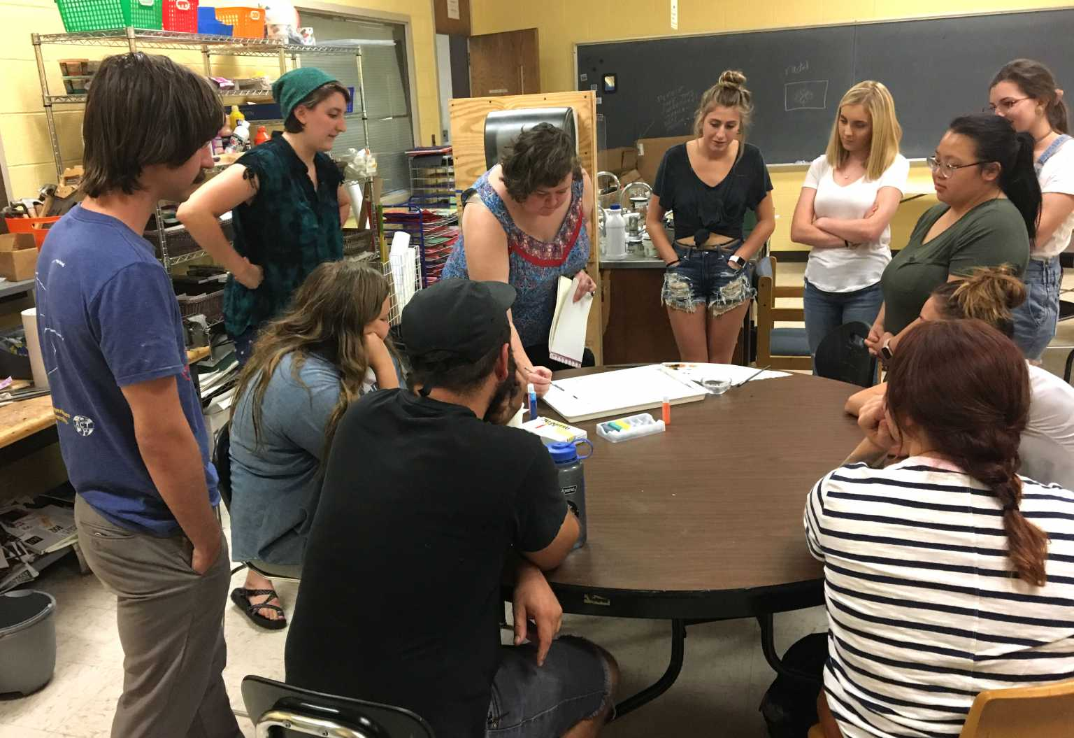 """Intro Art Ed. students listening and participating in their """"Teach Anything"""" projects."""