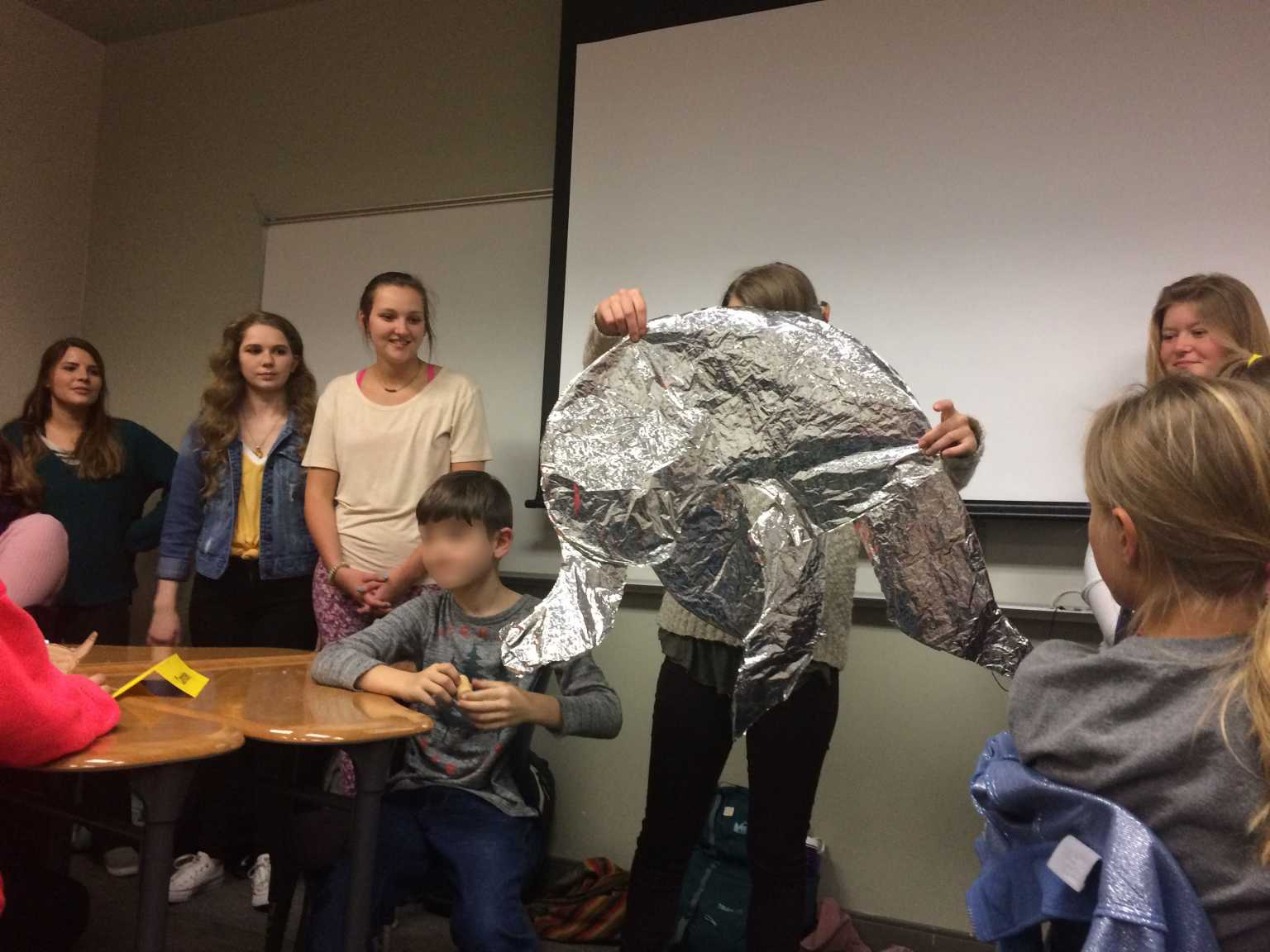 Art Ed. student make animals out of aluminum foil.