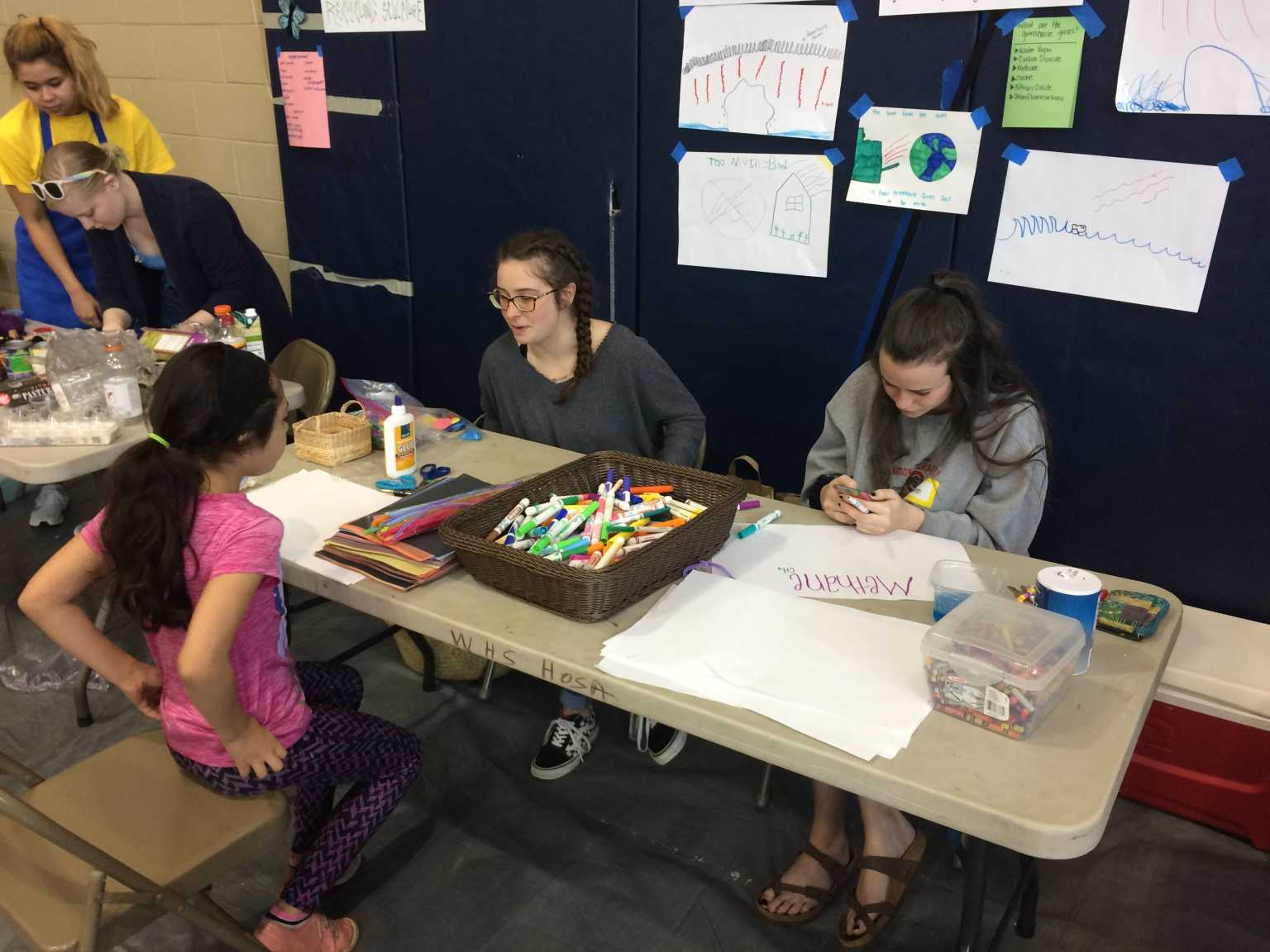 Elementary Ed. students work with young people to create environmental artwork at the BUILD Fest event in Boone.