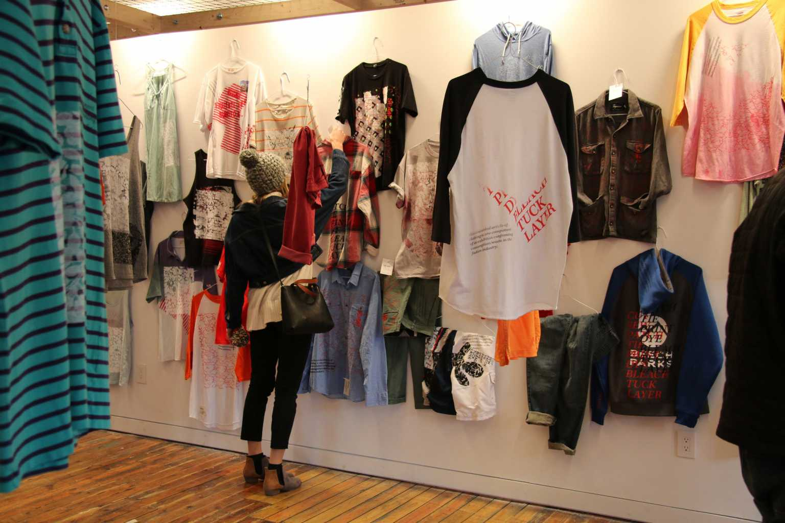 SEAM exhibition featuring altered, donated clothing to confront consumption/waste in the fashion industry