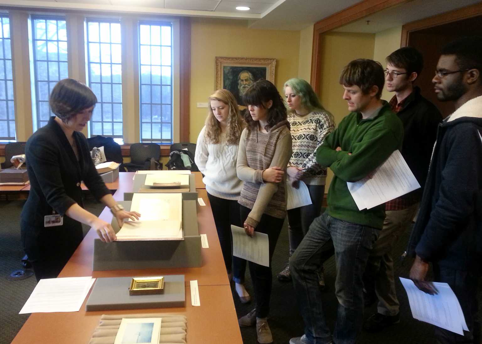 Examining a copy of Alexander Gardner's book of Civil War photographs in the Rubenstein Special Collections Library at Duke University