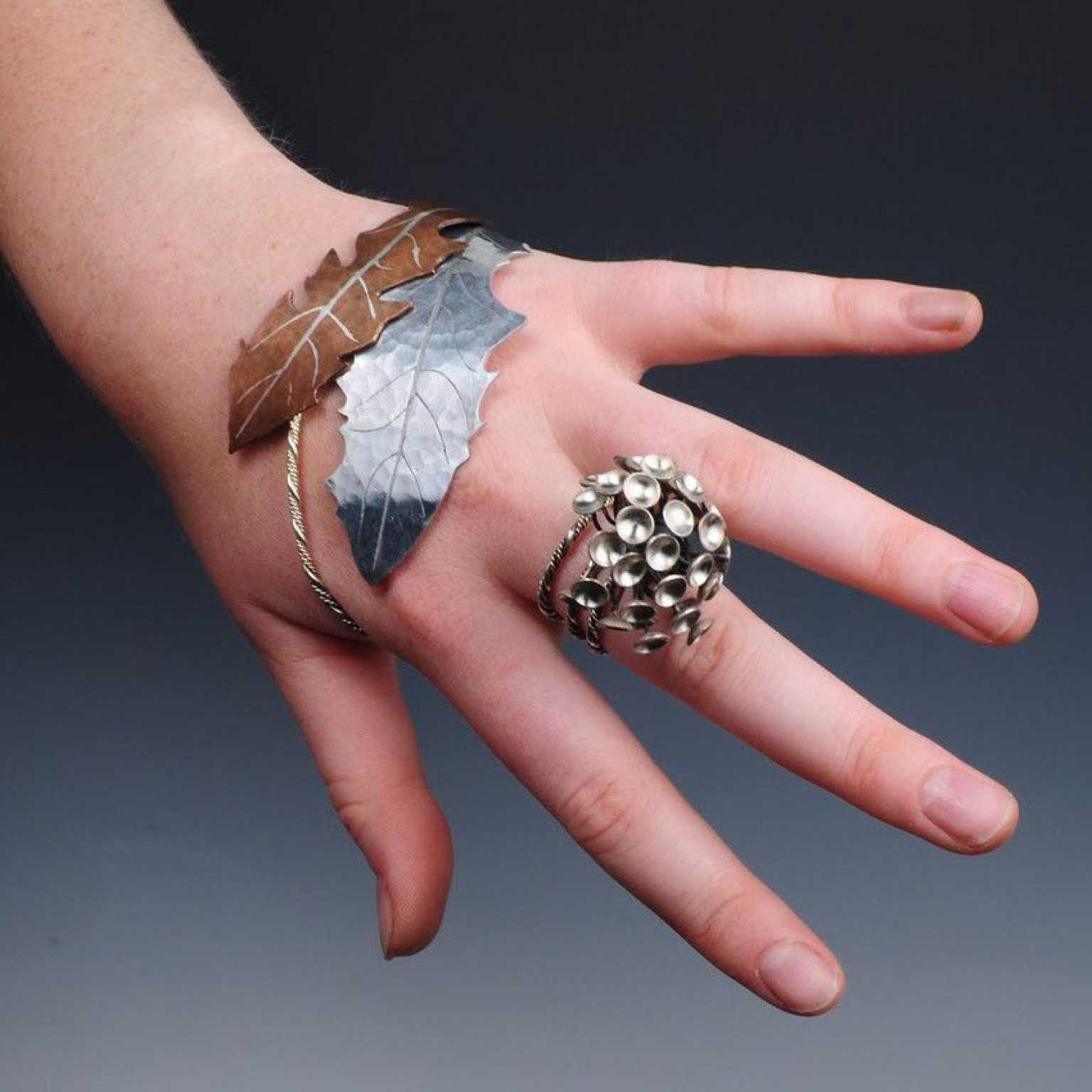 Elizabeth Walton, Stylized Dandelion Hand Piece , Mixed metals