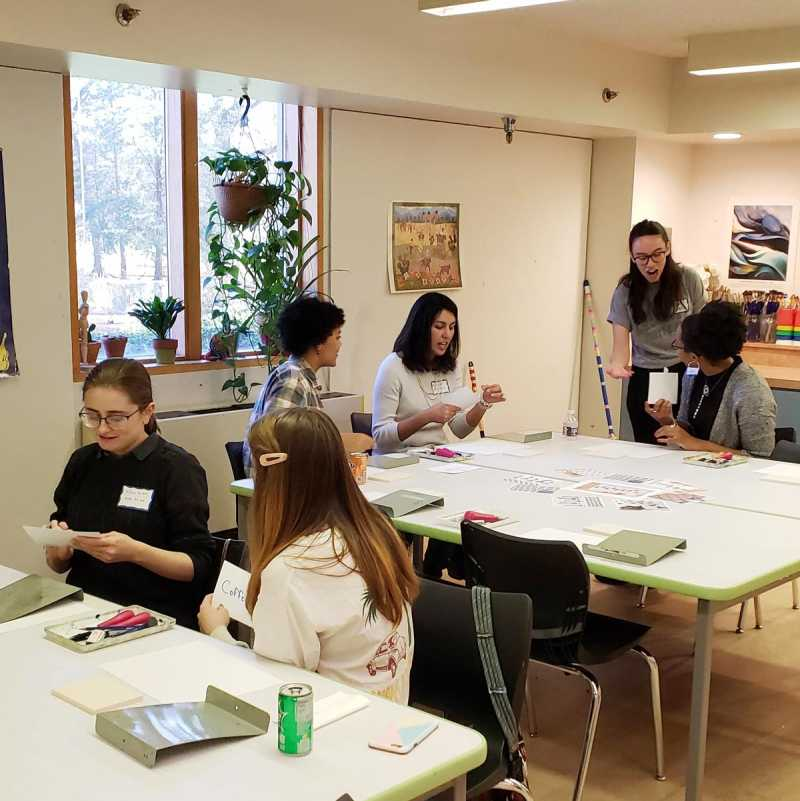 Art students and faculty engaged in an art-making activity